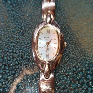 Ladies Fossil watch with opalescent face.